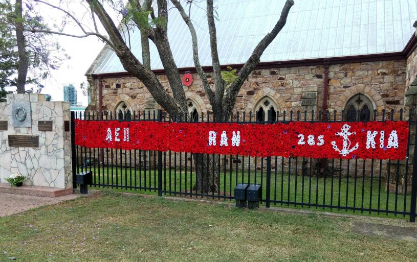"The ""Wall of Honour"" flanking the Canon Garland Memorial - ANZAC Day Origins beside St Mary's Anglican Church, 455 Main Street, Kangaroo Point, Brisbane, on 11 November 2018: the Centenary of Armistice Day."
