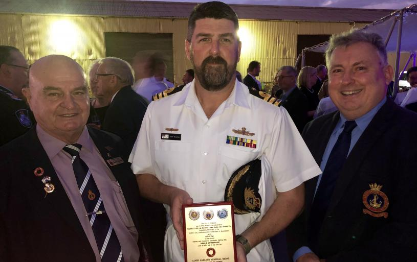 The presentation and Investiture Ceremony of the Canon Garland Memorial Medal to HMAS Brisbane, aboard same on 4 April 2019 as she was tied alongside Hamilton Wharf, Brisbane. Commanding Officer CDR Josh Wilson RAN accepted the Medal on behalf of Ship's Company.
