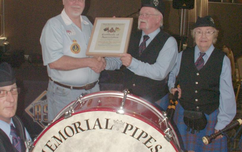 "President Bungy Williams presenting ""Certificate of Appreciation"" to the Townsville RSL Pipe Band for all their assistance."