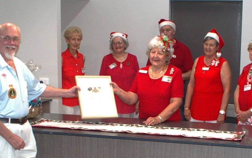 Our President Bungy Williams presenting a Certificate of Appreciation to the catering staff at our Christmas Party, Dec 2020