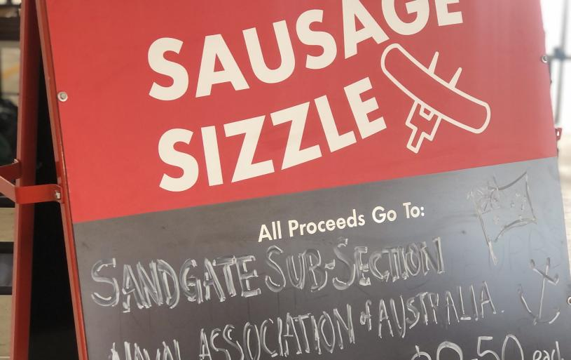 A sign complete in good taste! This was the scene as the COVID-19 regulations-affected sausage sizzle fundraiser got under way at Bunnings Virginia on 14 February 2021. Photo courtesy of Peter Collins.